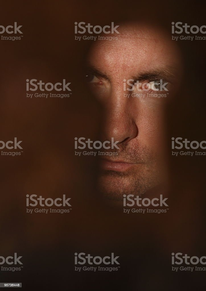 Peek through keyhole royalty-free stock photo