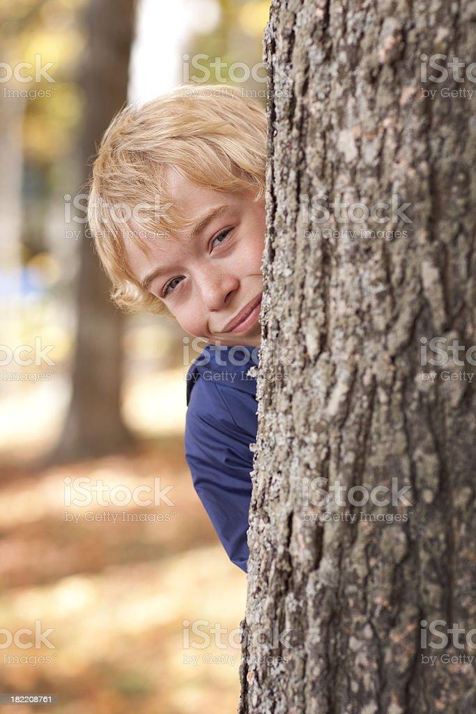 Peek-a-boo boy stock photo