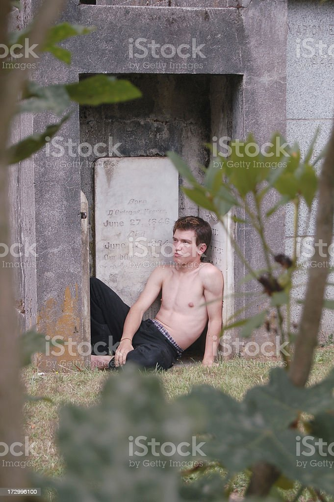 Peeking At a Mourner stock photo