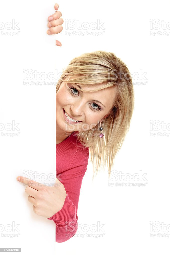 Peeking from behind the advert. royalty-free stock photo