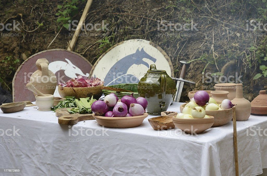 Peeled and cut onions in the vintage dishes stock photo