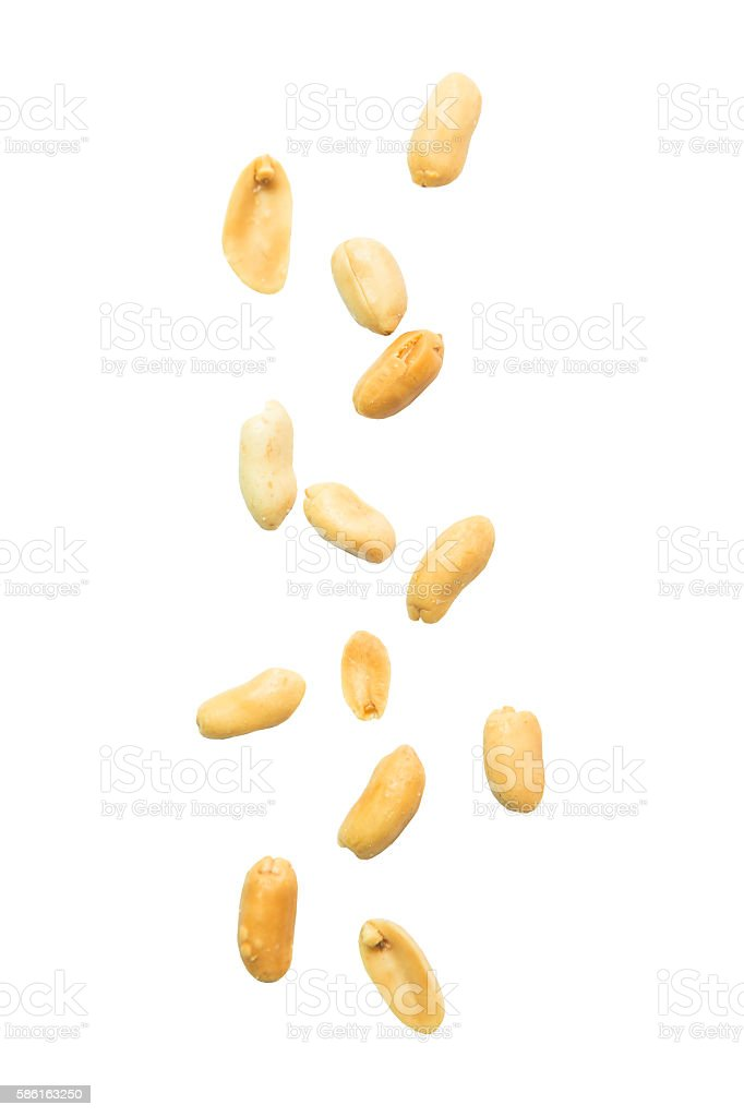 Peeled and salted peanut falling on white background stock photo