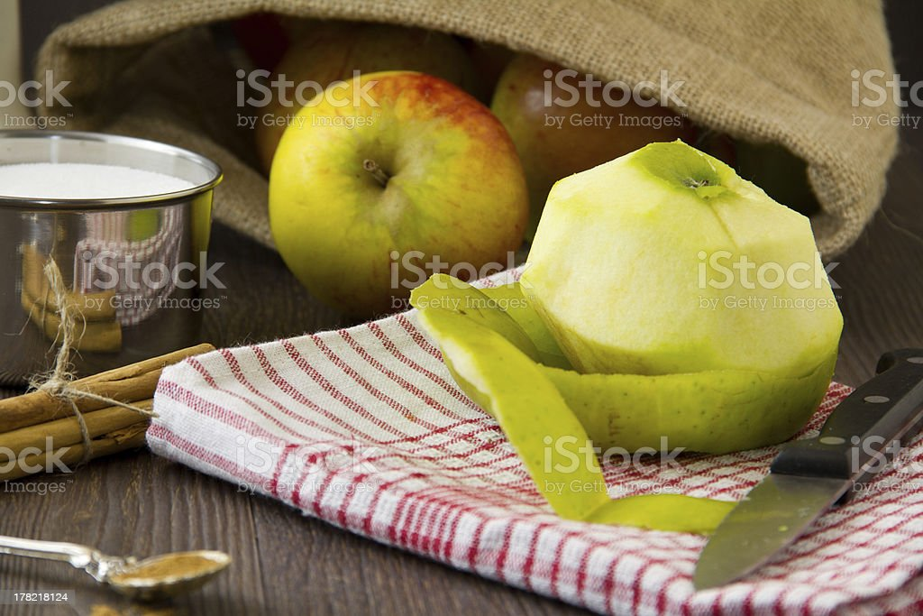 Peeled apple with ingredients for a pie royalty-free stock photo