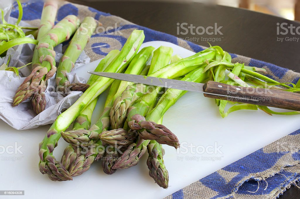 Peeled green asparagus stock photo