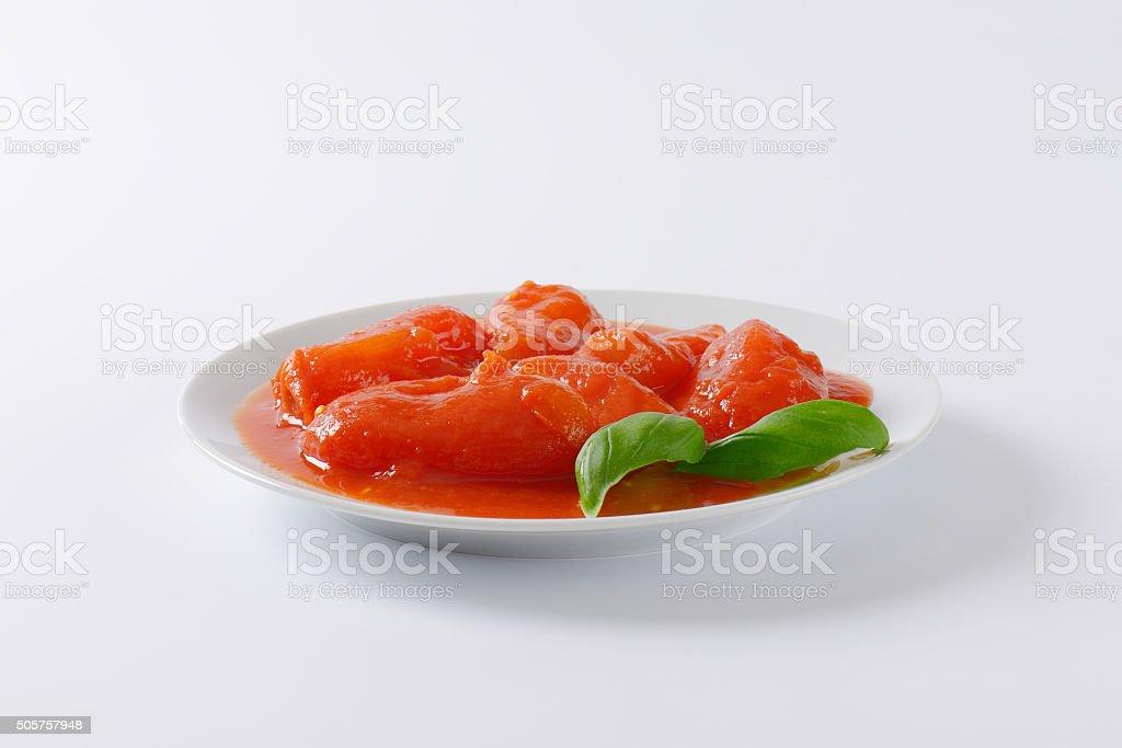 peeled plum tomatoes stock photo