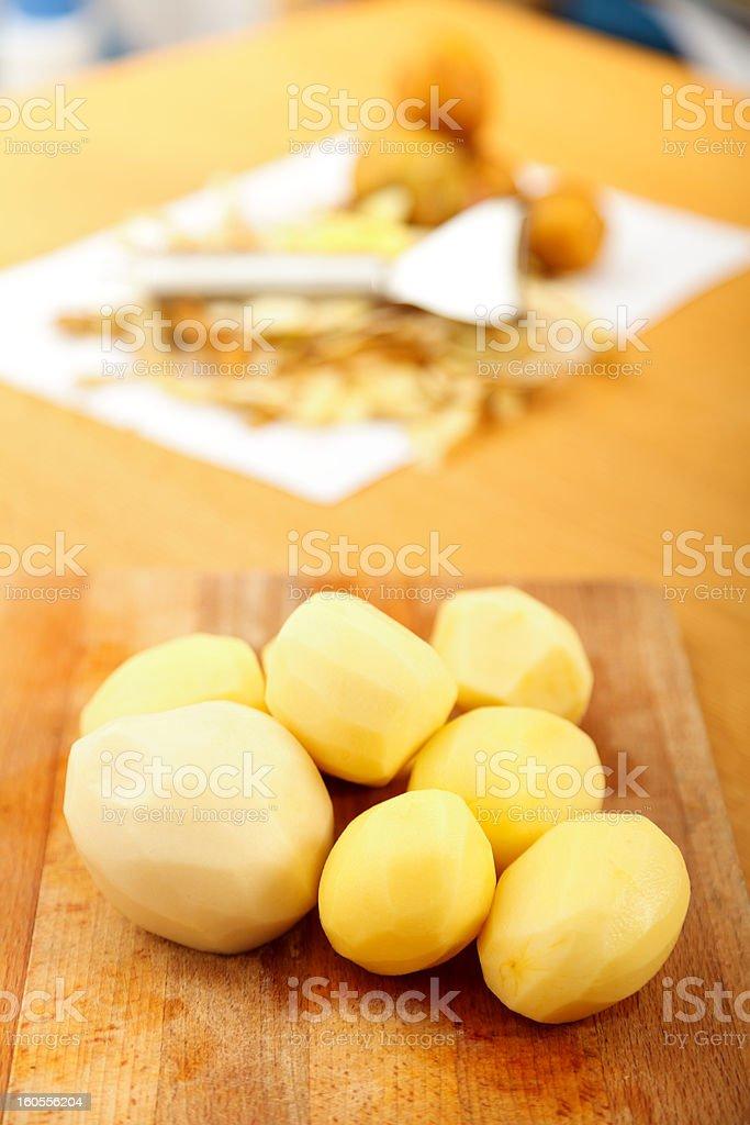 Peeled potatoes royalty-free stock photo