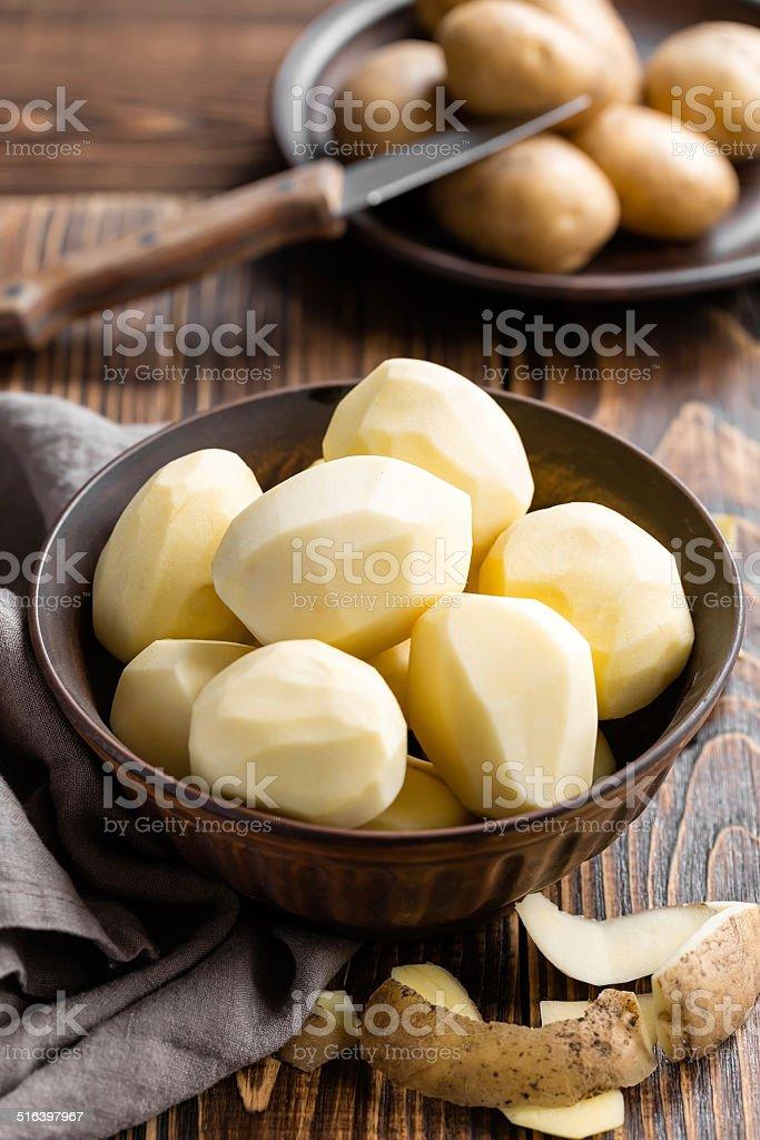 Peeled potatoes stock photo