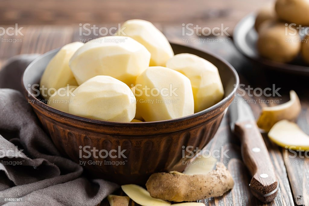 Peeled potatoes stock photo