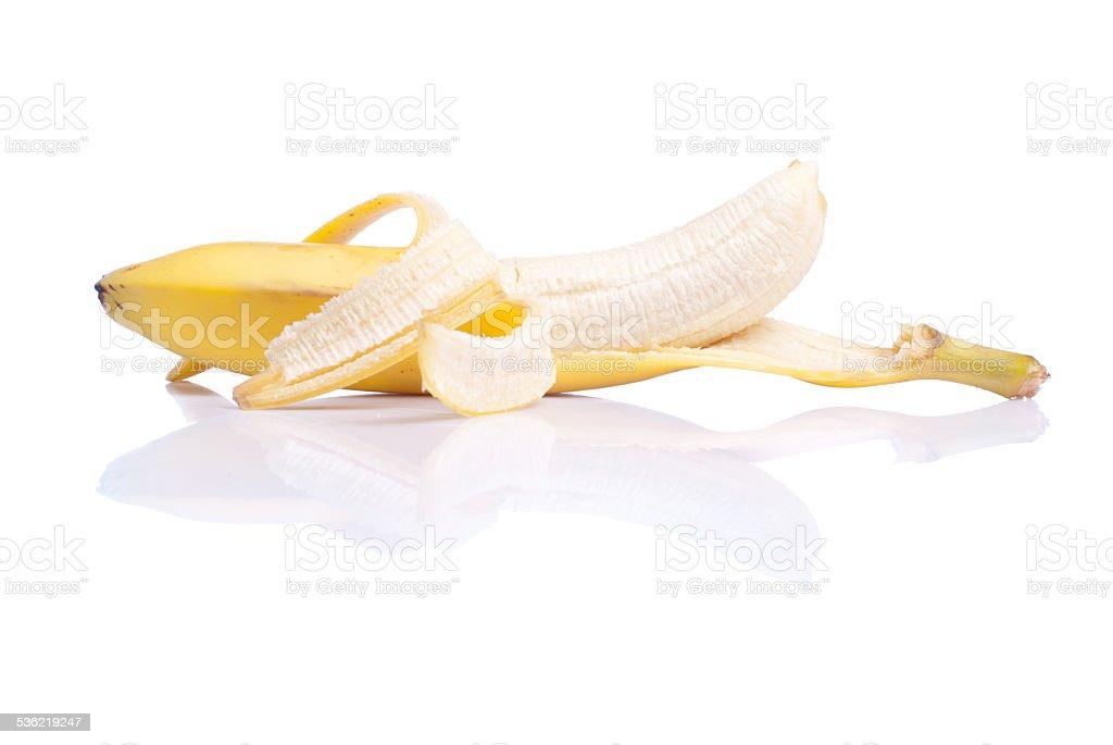 peeled ripe banana isolated on a white background with reflectio stock photo