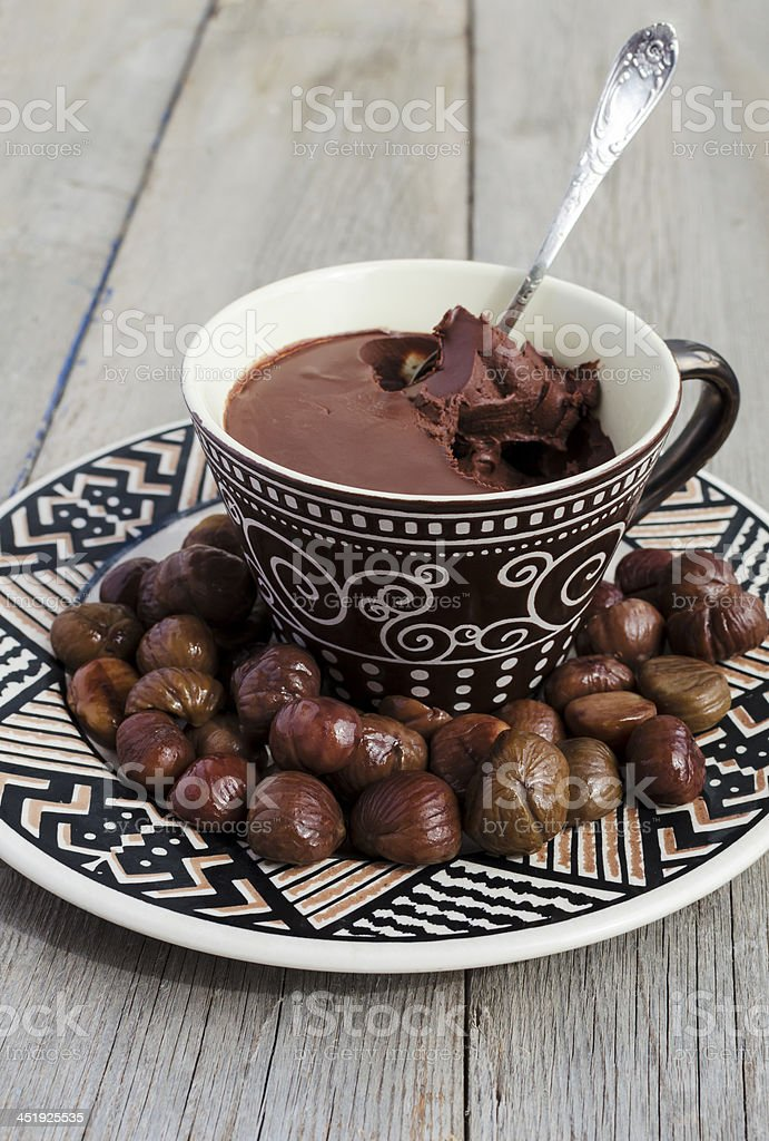 Peeled Roasted Chestnuts and chocolate cream ganache stock photo