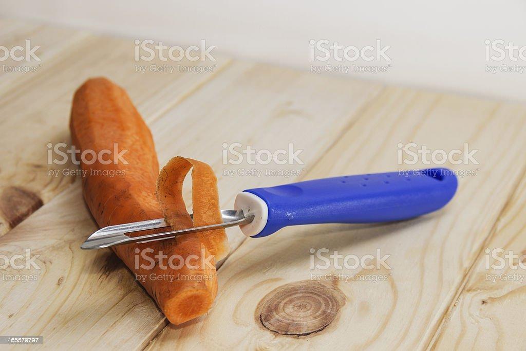 peeler and peeled carrots stock photo