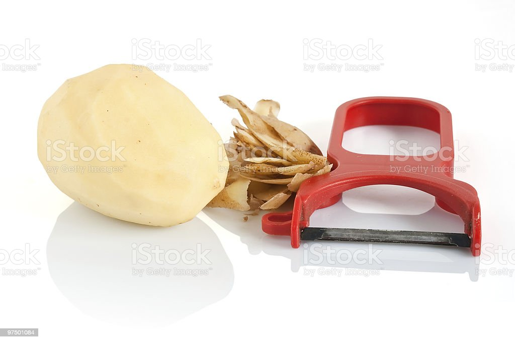 peeler with potato royalty-free stock photo