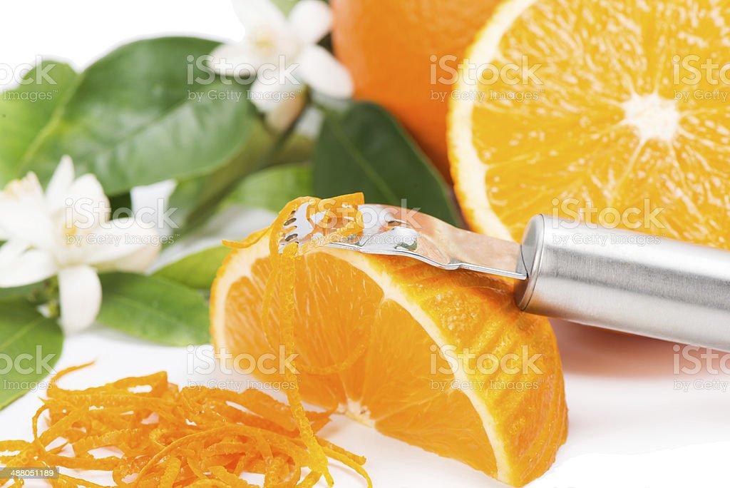 Peeling a oramge stock photo