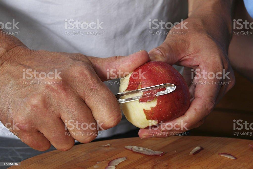Peeling an Apple royalty-free stock photo
