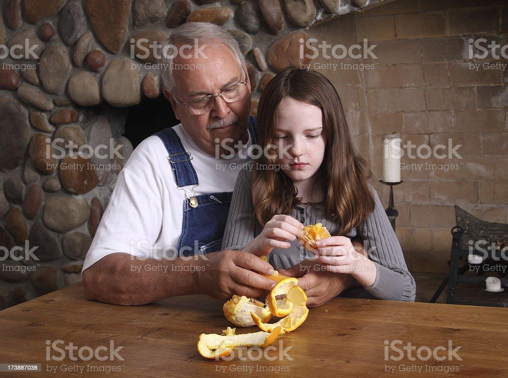 Peeling an Orange for Granddaughter royalty-free stock photo