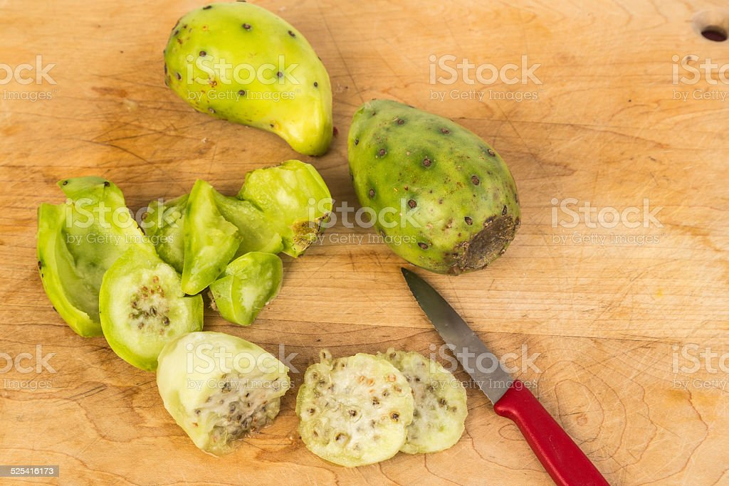 Peeling and Slicing Cactus Pears stock photo