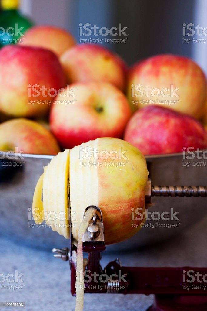 Peeling, Coring, and Slicing an Apple stock photo