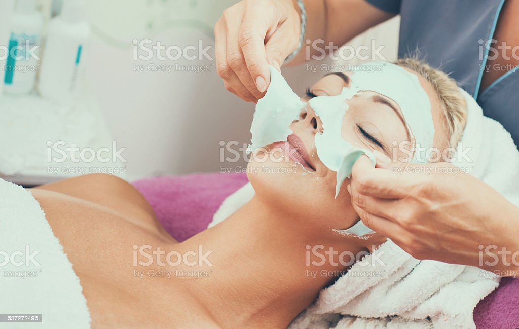 Peeling of facial mask. stock photo
