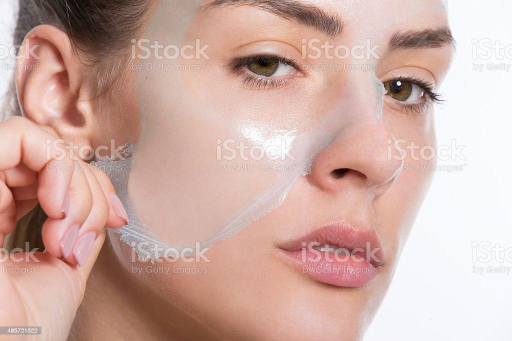 Peeling off facial mask stock photo
