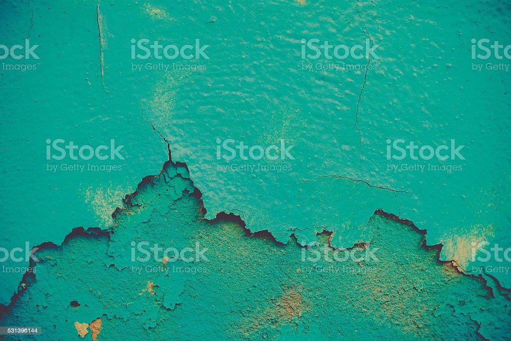 peeling paint on a plaster wall. stock photo