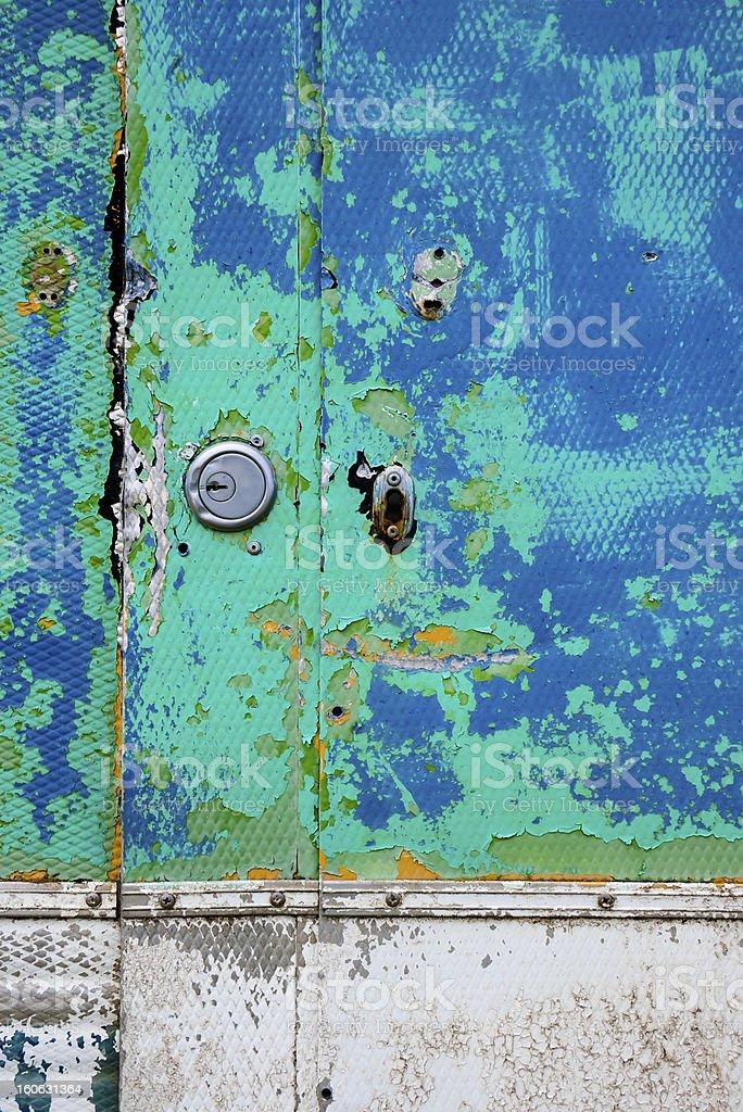 Peeling paint on an old car door royalty-free stock photo