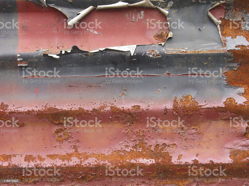 Peeling Paint on Rusted Metal, Distressed Corrugated Background, Close-up royalty-free stock photo