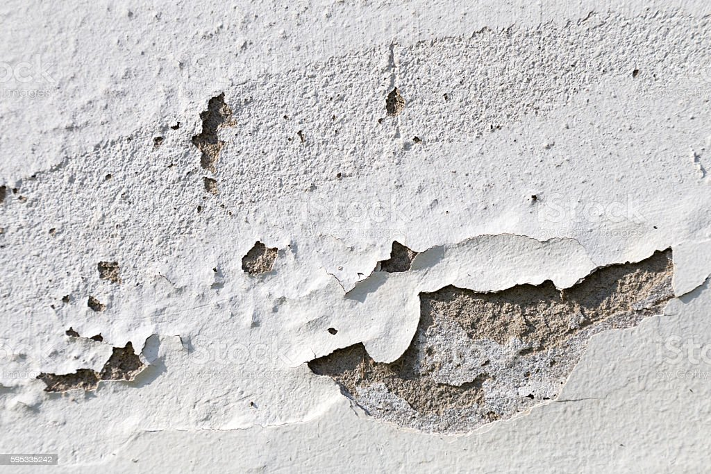 peeling paint on the white concrete wall stock photo