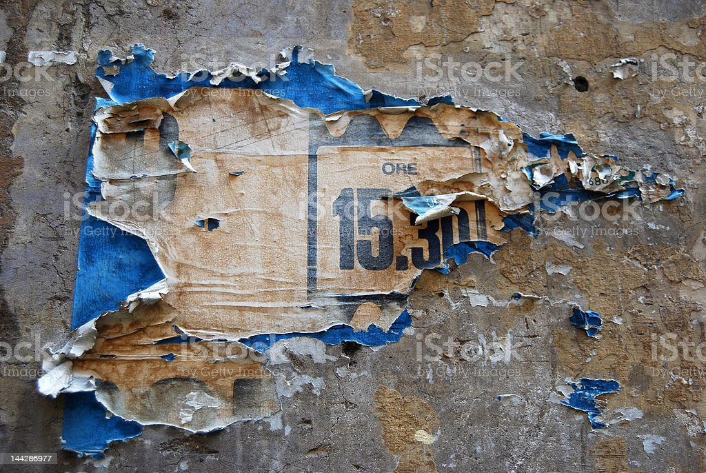 Peeling poster on wall royalty-free stock photo