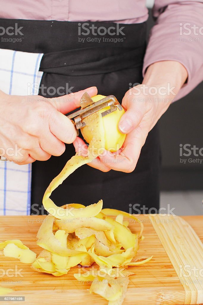 Peeling Potato stock photo