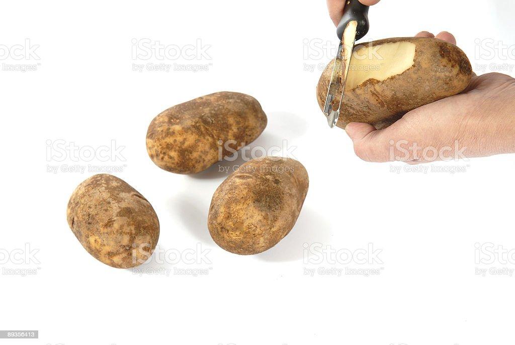 Peeling Potato royalty-free stock photo