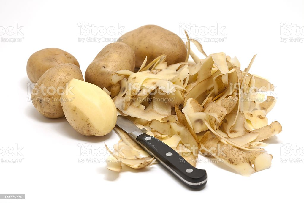peeling potatoes stock photo