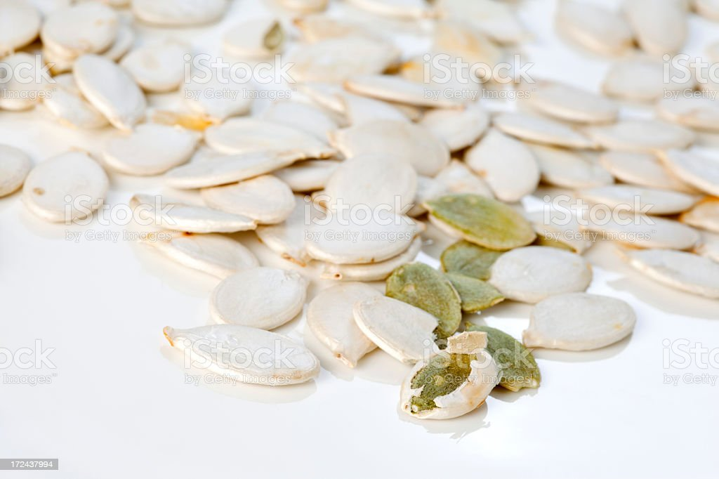 Peeling pumpkin seeds royalty-free stock photo