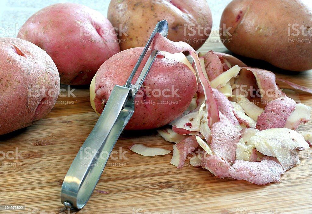 Peeling Red Potatoes royalty-free stock photo