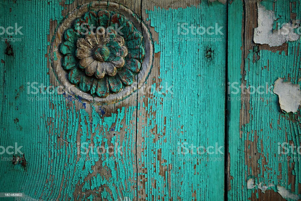 Peeling turquoise color wooden door detail royalty-free stock photo