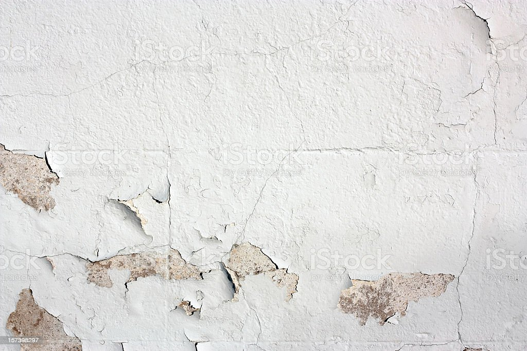 Peeling white-painted wall detail royalty-free stock photo