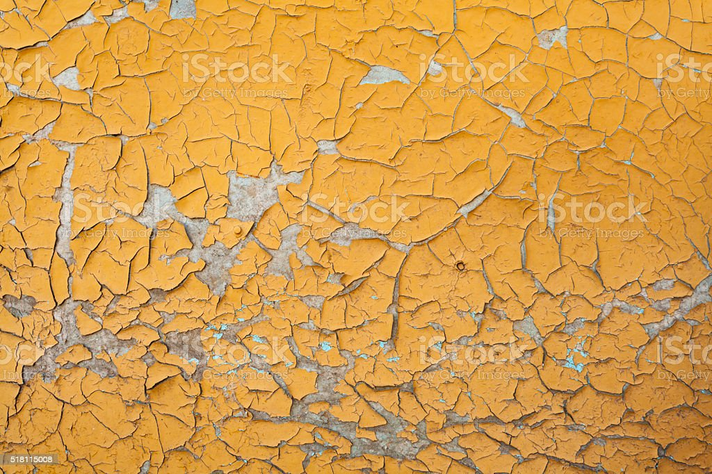Peeling yellow  paint on wall seamless texture. stock photo