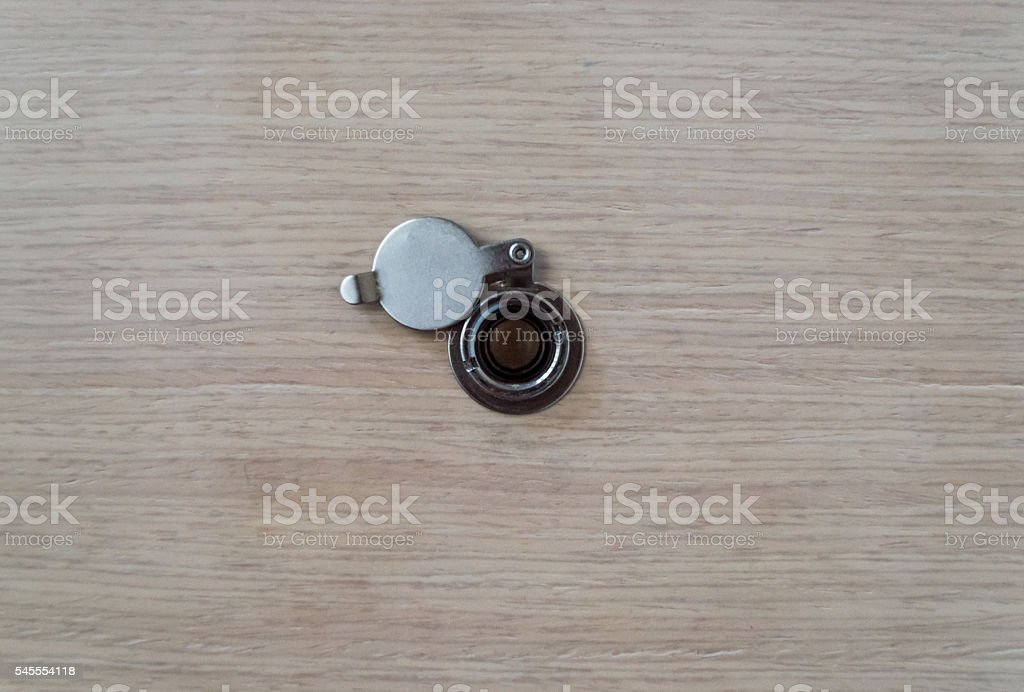 Peephole in a Wooden Door Background Central View stock photo