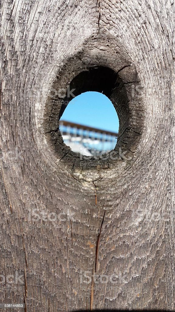 Peephole in a wooden fence stock photo