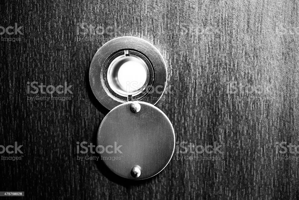 Peephole in the door stock photo