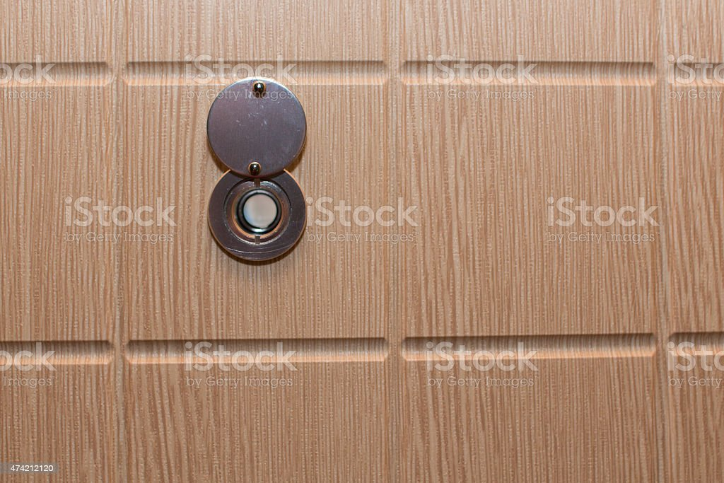 Peephole on the door stock photo