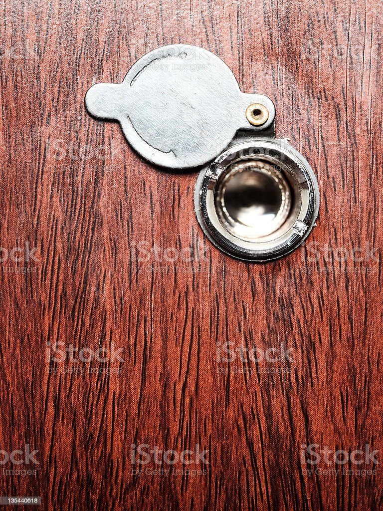 Peephole on wooden door royalty-free stock photo