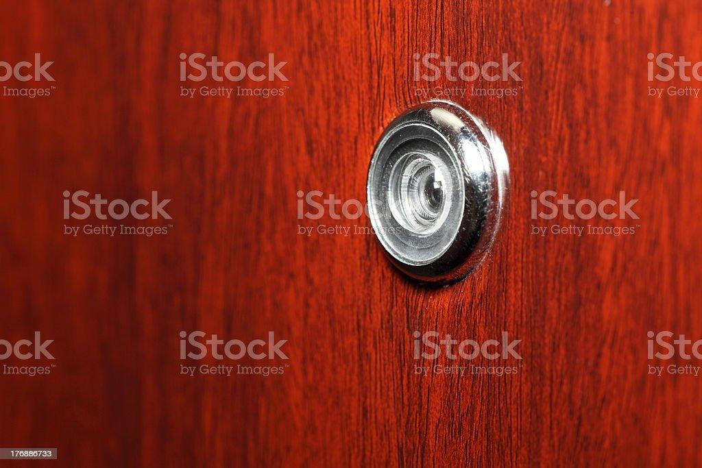 Peephole on wooden door royalty-free stock photo