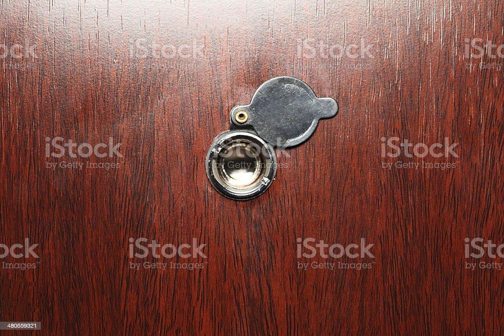 Peephole on wooden door stock photo