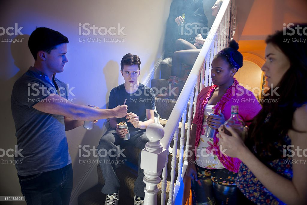 peer pressure at a house party stock photo