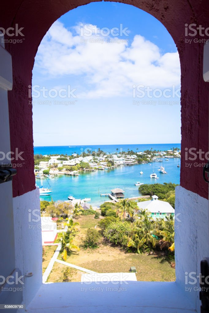 Peering out at hope town harbor from the lighthouse stock photo