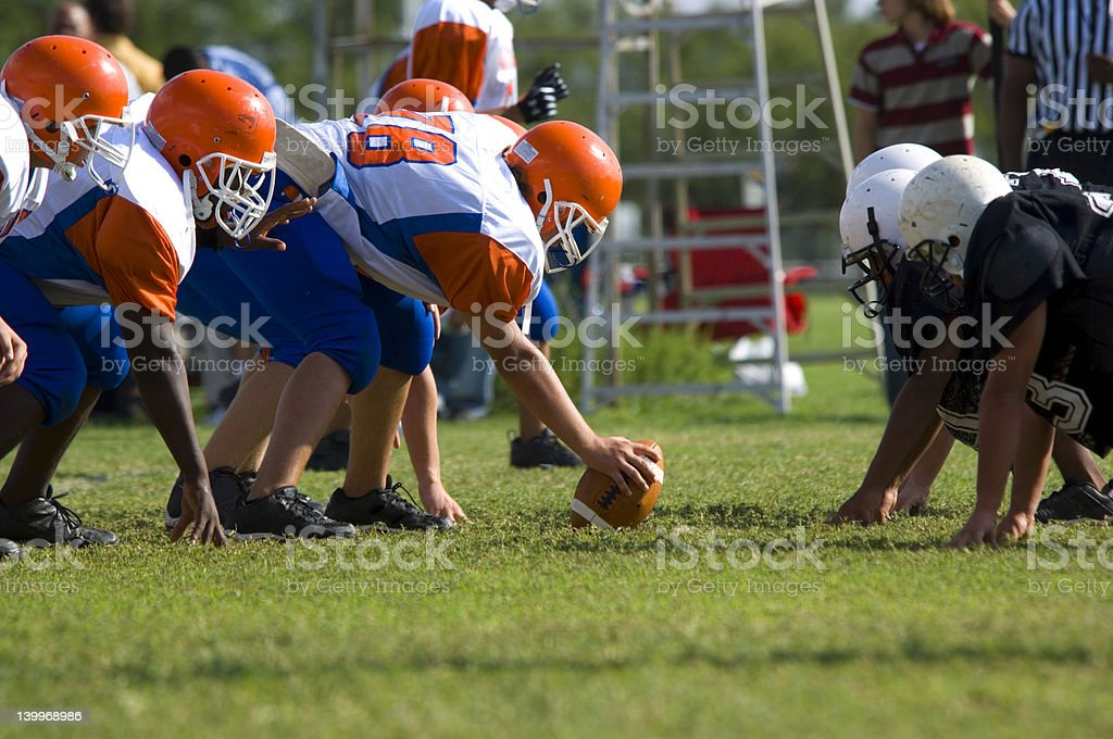 Peewee American football game between two teams stock photo
