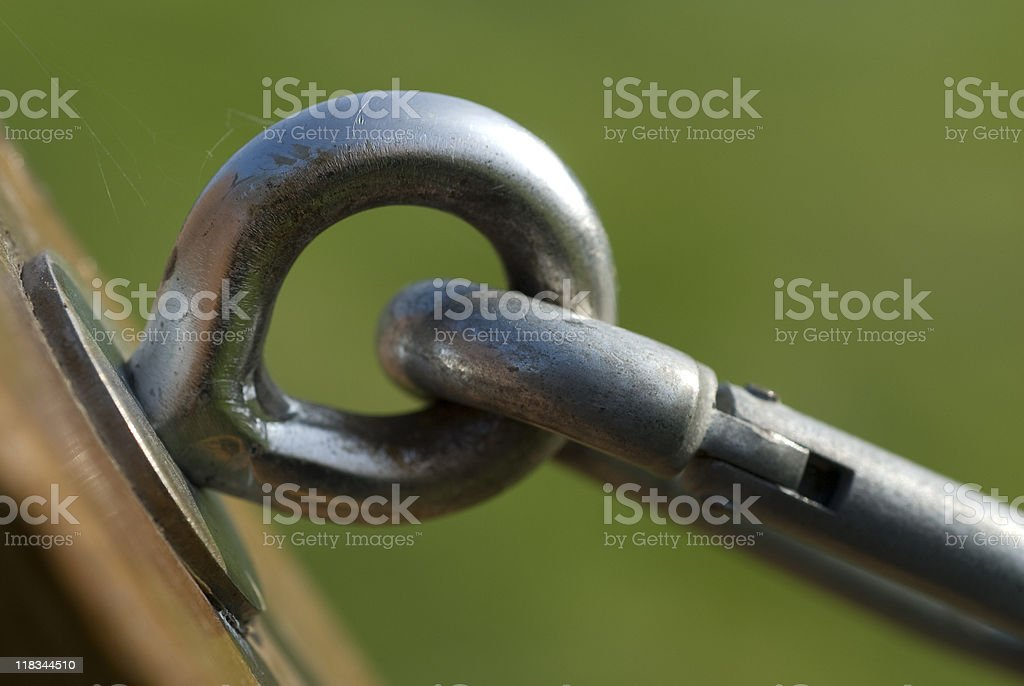 Peg and carabiner on wooden post, close-up royalty-free stock photo