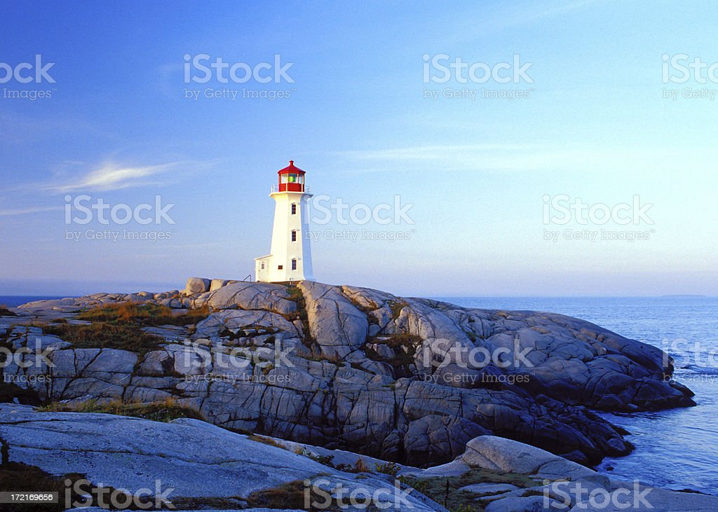 Peggy's Cove lighthouse at sunrise royalty-free stock photo