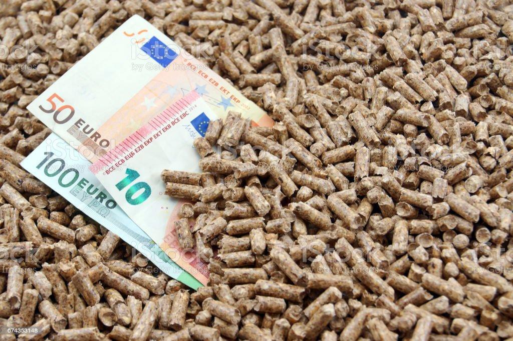 Pellets on money stock photo