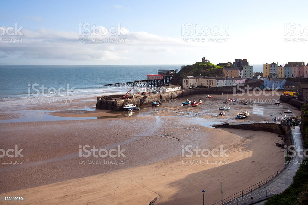 UK, Pembrokeshire, Tenby, houses around the harbour at low tide stock photo